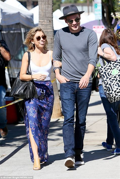 Maxi Shofia Mol hyland cuts a chic figure with boyfriend dominic sherwood ahead of the emmys daily mail