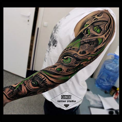 full arm tattoo skull and arm sleeve