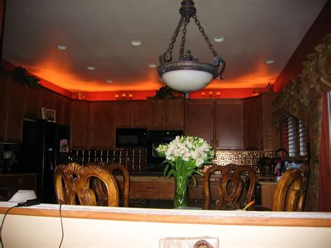 rope lights above cabinets in kitchen above cabinet lighting