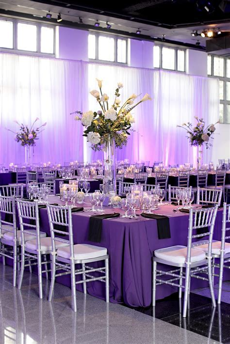Beautiful. Rectangle tables, purple tablecloths, silver