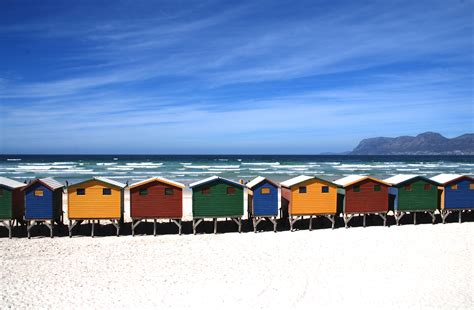 cottages near the sea colorful cottages near the sea blue sky during