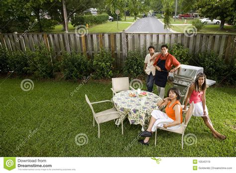 family in backyard royalty free stock images