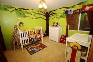 Jungle Themed Nursery Decor Jungle Theme Baby Room Nursery With Painted Tree Green Walls Jungle Animals And White