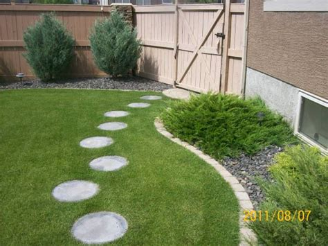 these round stepping stones lead to the back patio area