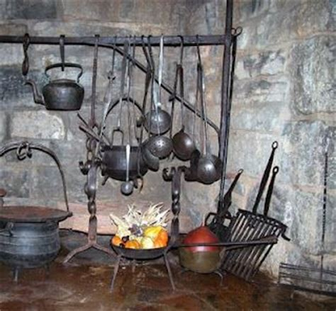colonial fireplace with cooking tools pioneer