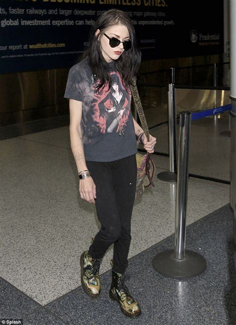 frances bean cobain in graphic shirt and doc martens as