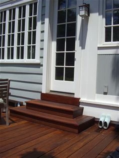 wrap around porch steps to door covered deck and open possible solution to raised back door backyard