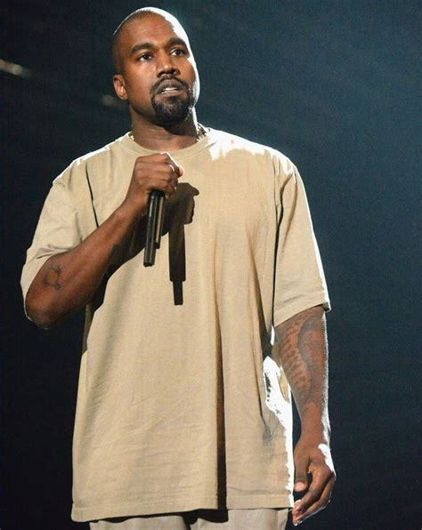 kanye west tattoos kanye west cries mid performance his late donda