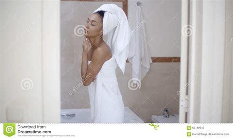 head bathroom woman with towel on head in the bathroom stock photo