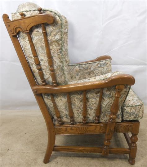 ercol armchair cushions carved elm upholstered wing armchair old colonial range by
