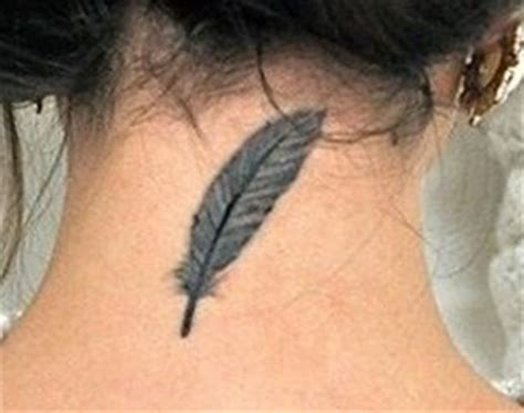 feather tattoo back of neck neck tattoos tattoo insider
