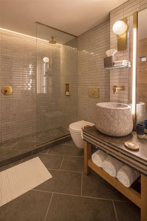 Modern Hotel Bathrooms by The Made Hotel In New York Includes Warm Wood Elements