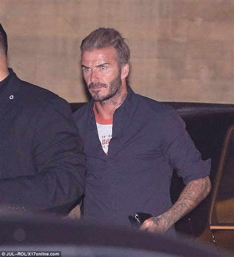 neck tattoo with suit david beckham reveals large horse neck tattoo on his neck