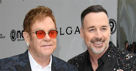 elton john and husband elton john s husband david furnish dashed home from hols
