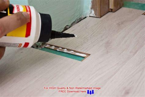 lying on the bathroom floor laying laminate flooring in bathroom jpg acadian house plans