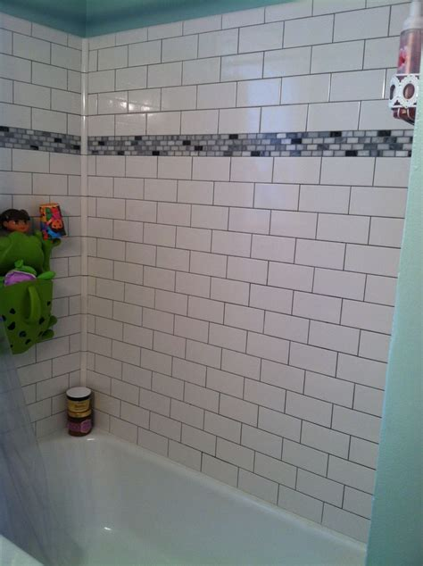 bathroom tile strips tub surround subway tiles and grout on pinterest