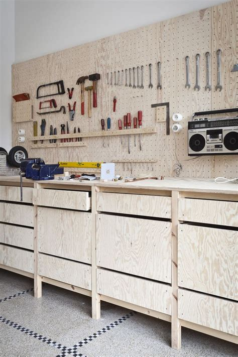 garage tool bench ideas bench is off floor pegboard is a good idea i like the