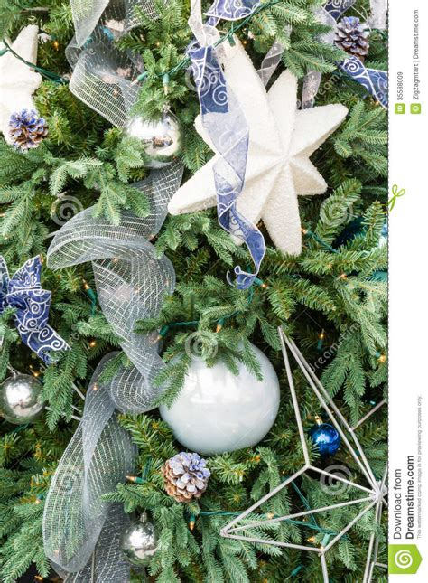 christmas tree decorated with blue and white stock image