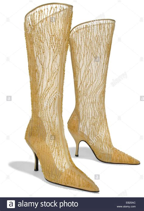 gold high heel boots gold high heel boots is heel