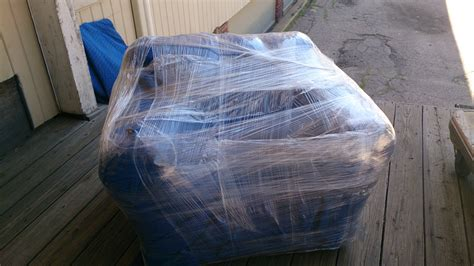 how to shrink wrap a couch you won t believe what s happening at casey movers how to