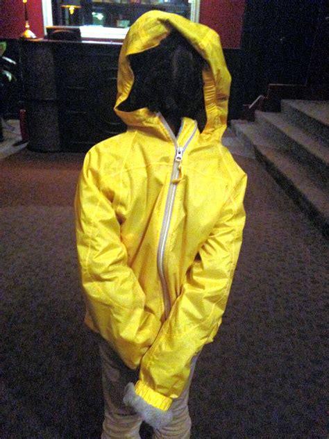 girl wearing yellow windbreaker  steven depolo flickr