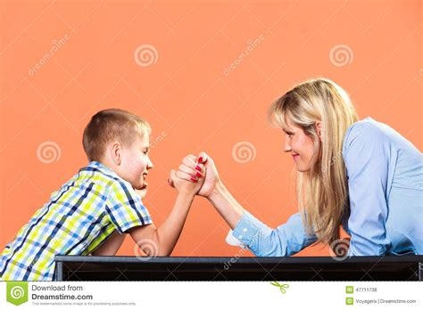 middleage woman fun mother and son arm wrestling stock photo image 47711738