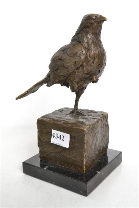 Bird L Base by A Bronze Of A Bird On Marble Base