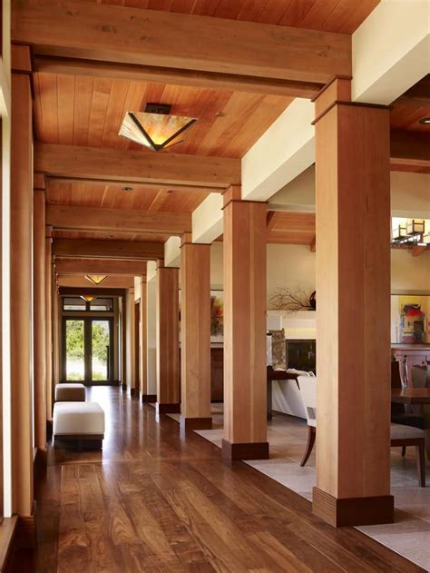 Contemporary open hallway with wooden columns and ceiling