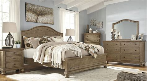 bedroom l set trishley light brown panel bedroom set b659 57 54 96 ashley