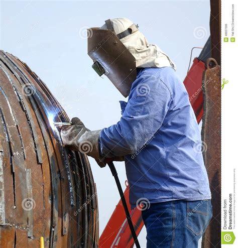 Kaos Welder Metal Workers welder using cutting torch to cut a rail editorial image cartoondealer 79584520