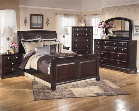ridgley 4 sleigh bedroom set in brown