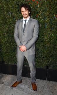 franco grey suit blue tie handsome smile disregard
