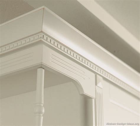 white cabinets with crown molding pictures of kitchens traditional off white antique