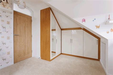 Fitted Wardrobes For Sloping Ceilings by Fitted Wardrobes Hinged Made To Measure Wardrobes