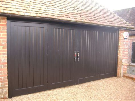 Bifold Garage Door by Bi Fold Folding Wooden Garage Doors Tongue And Groove