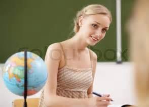 Children Study Desk Young Female Teacher Working With Children At