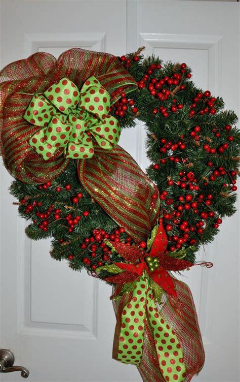 Elegant holly and poinsettia christmas wreath by wreathsbyrose 70 00