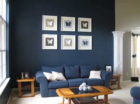 dark blue paint living room painting room with hues of blue