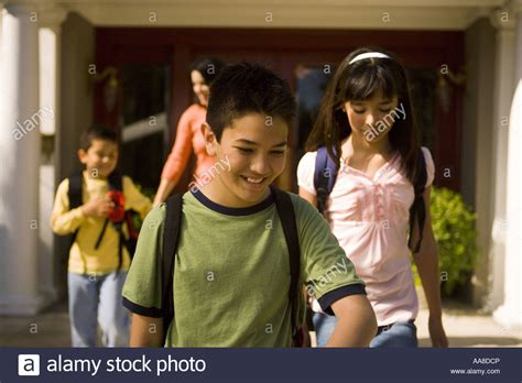 when to walk away from buying a house mom and children with backpacks walking away from house stock photo royalty free