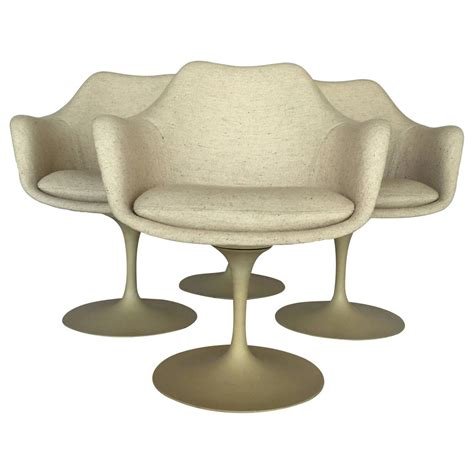 set of four early production tulip chairs by eero saarinen