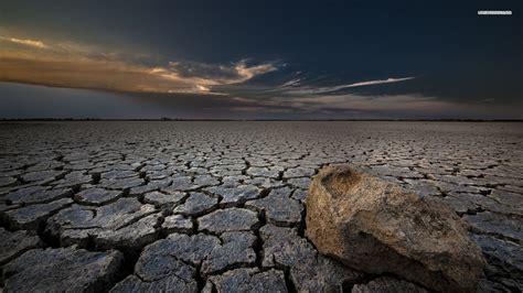 Cracked Soil In The Desert Wallpaper