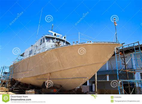dry dock boat repair military boat on repair in dry dock stock images image