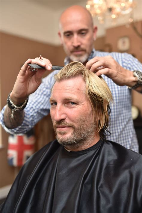savage look haircut photos robbie savage has his hair cut birmingham mail