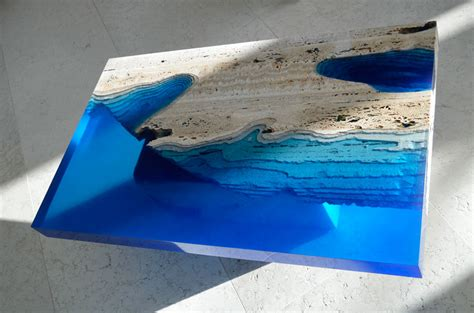 Acrylic Meja handmade lagoon tables made from resin and cut travertine marble