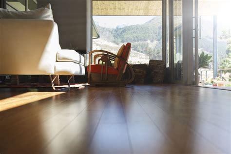 living room laminate vs hardwood wood interior floor plank vinyl flooring faqs answered