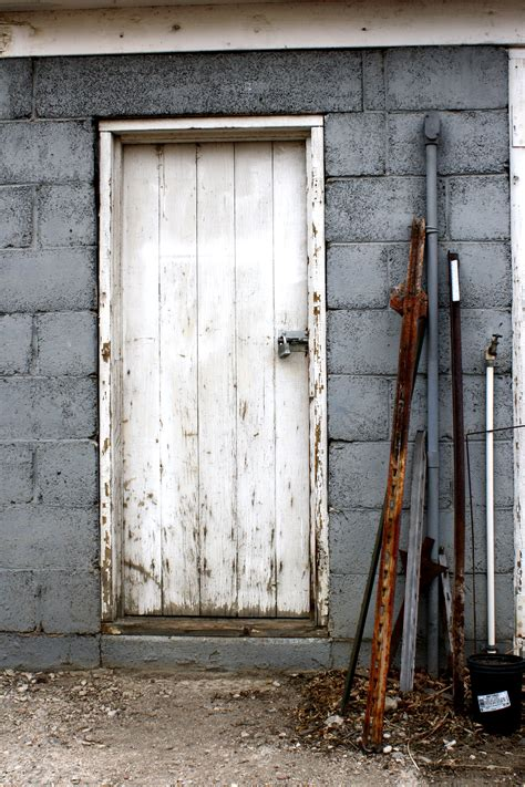 free doors shed door with metal stakes leaning next to it picture