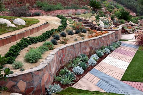 landscape designs for backyard slopes slope lanscape and garden ideas mediterranean landscape san diego by singing