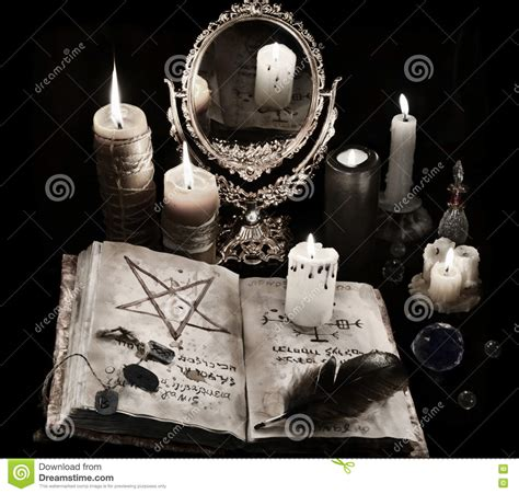 candela nera magia mystic still with runes and candles stock