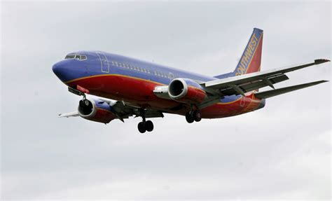 it s time for all airlines to stop overselling flights chicago tribune