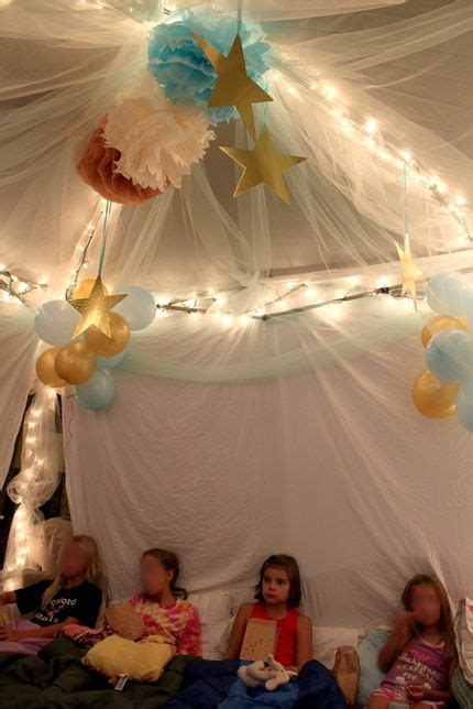 use pop up canopy tent, hang sheets on side, hang tulle